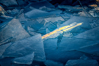 A sliver of light; stacked ice