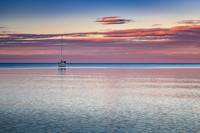 Sunset colors with sailboat