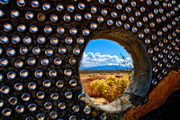View through wall at Earthship house