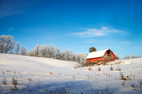 Red barn on a frosty winter day